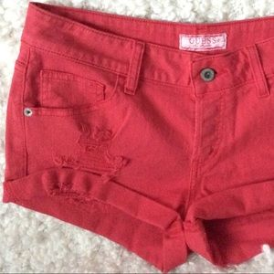 GUESS red buttoned mid-rise distressed jean shorts